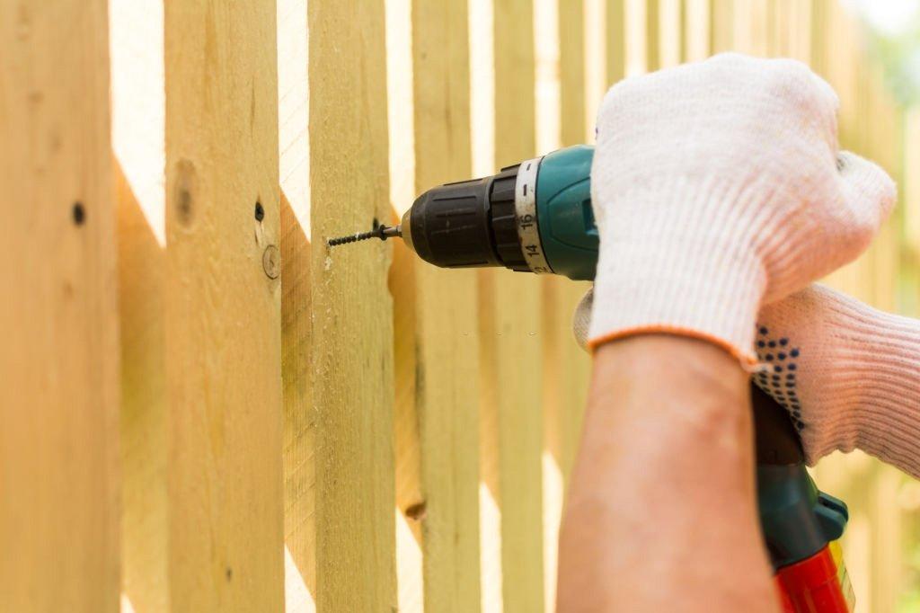 repairing wooden fence